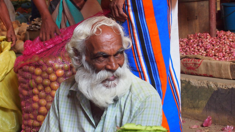 Photo of an old Sri Lankan man in a market