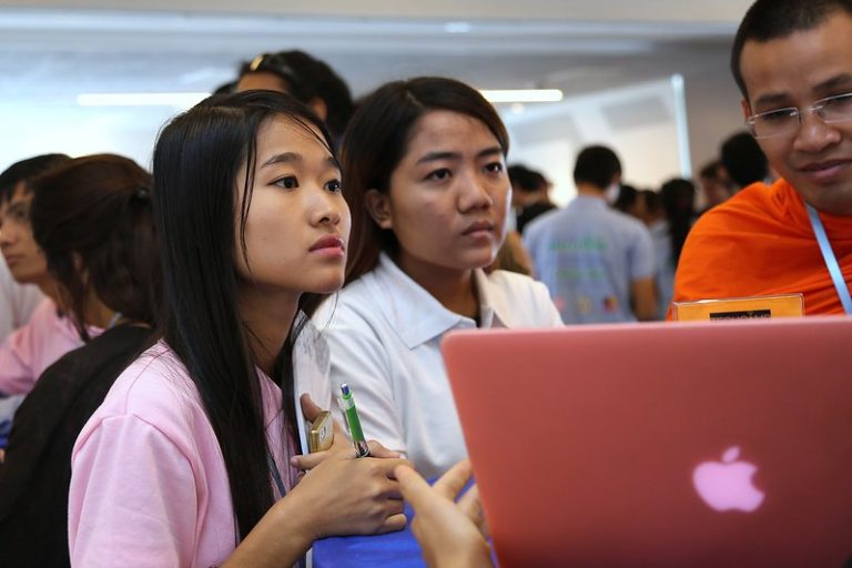 2 Cambodian teen girls looking at a laptop