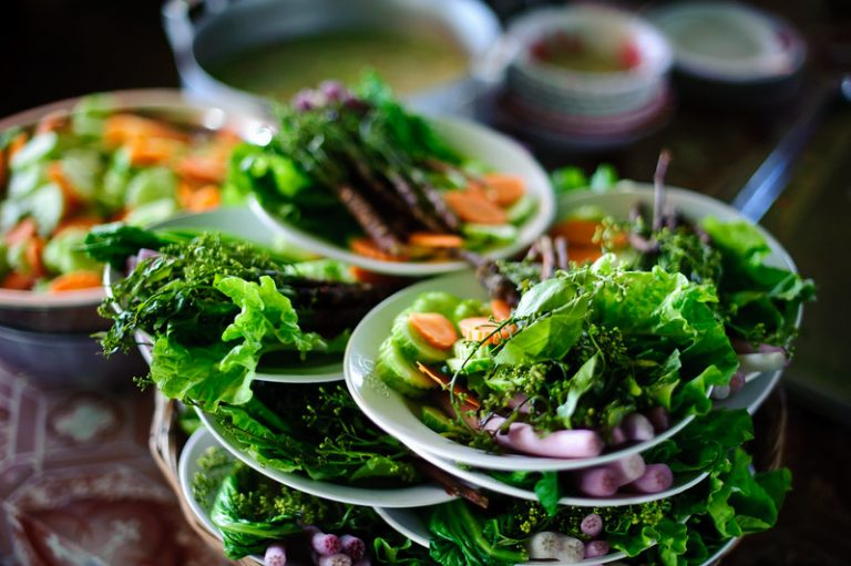 Close up of plates of vegetables in Cambodia