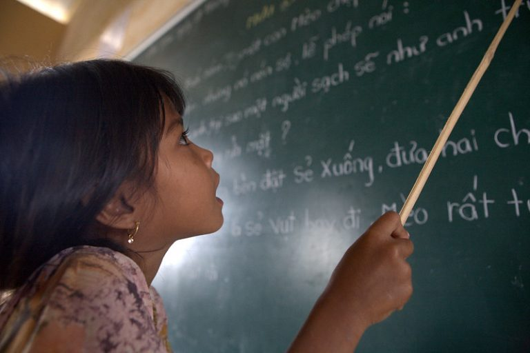 khmer girl learning to write