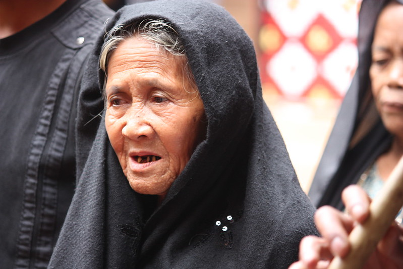 Indonesian woman singing in funeral attire
