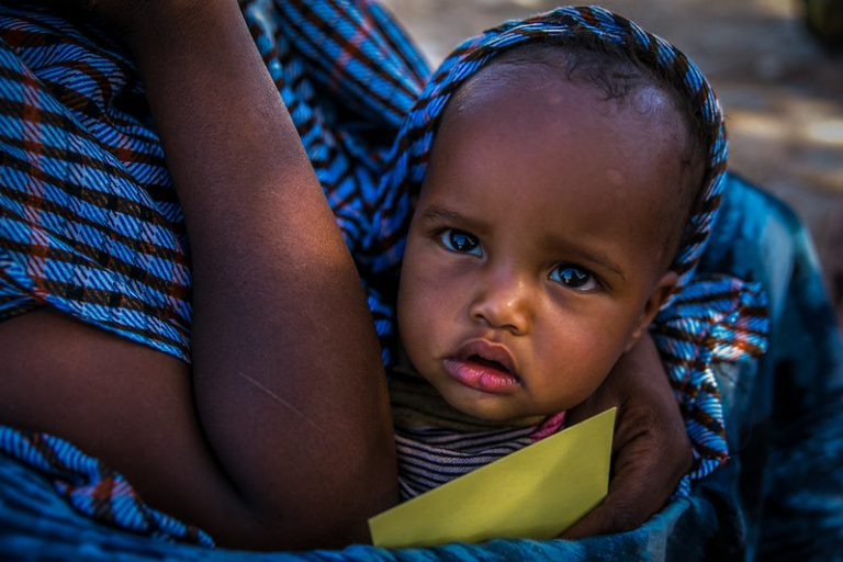 Somali Baby with blue clothing