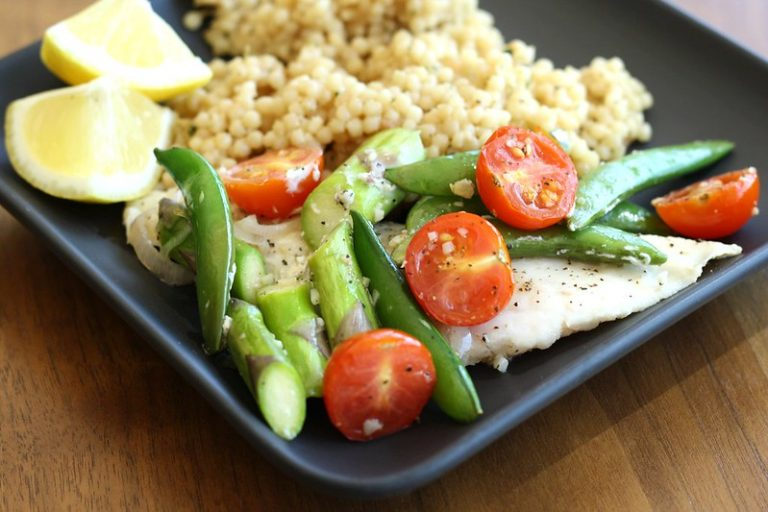 Healthy meal with fish, rice and vegetables