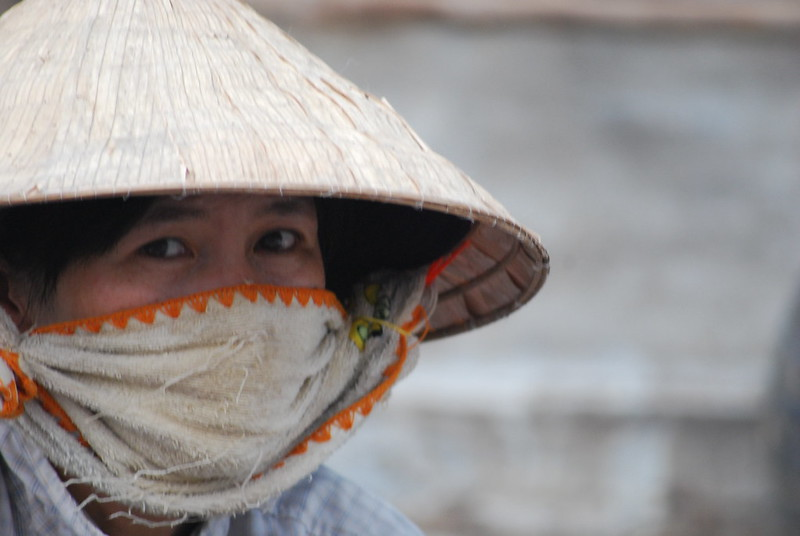 Vietnamese woman in traditional hate