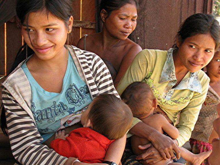 Cambodian women feeding babies.