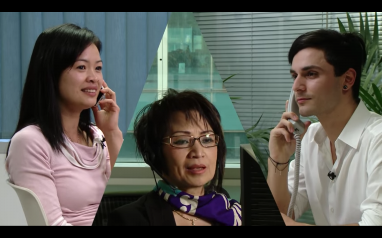 Image of 2 people talking with an interpreter in the middle