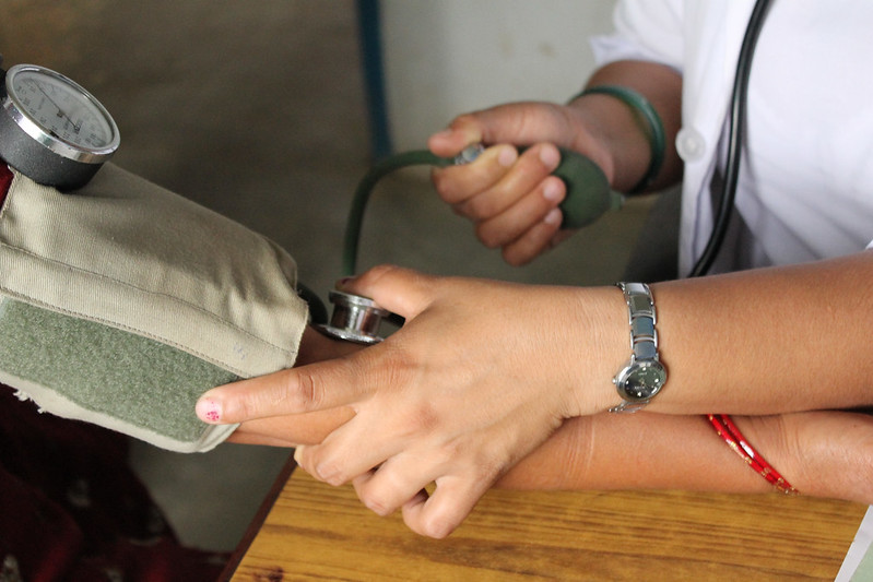 close up of hands taking blood pressure