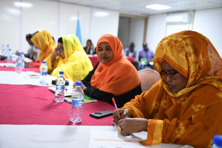 4 Somali women at a table