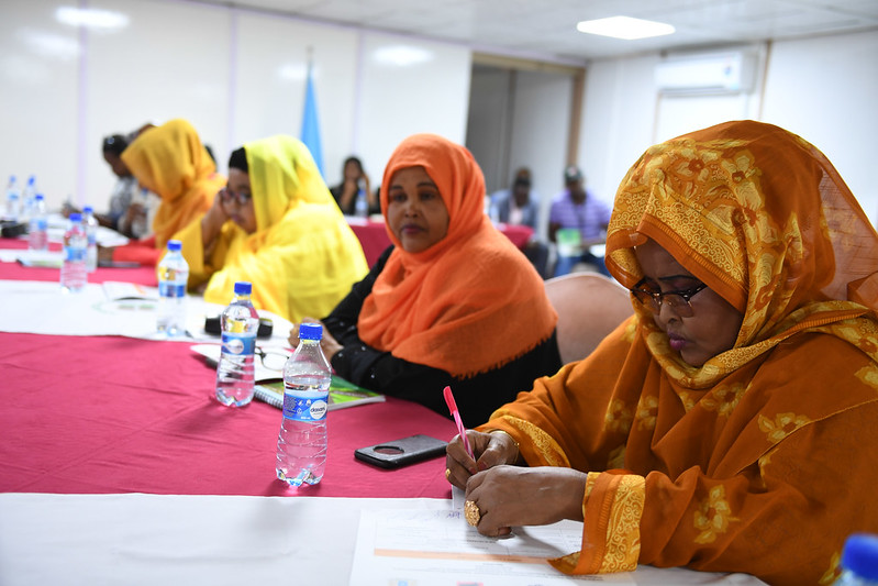 4 Somali women at a table