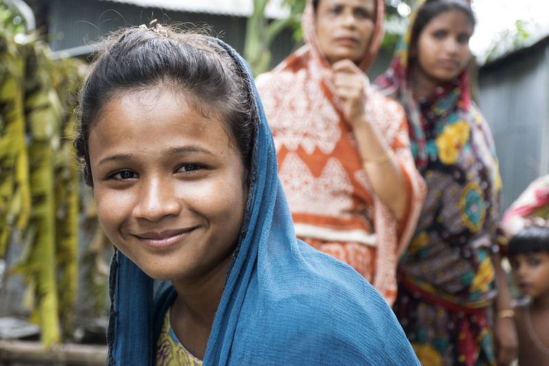 Picture of a South Asian girl with two women in the background