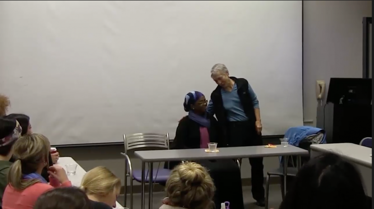 Still image from video of two women giving a presentation