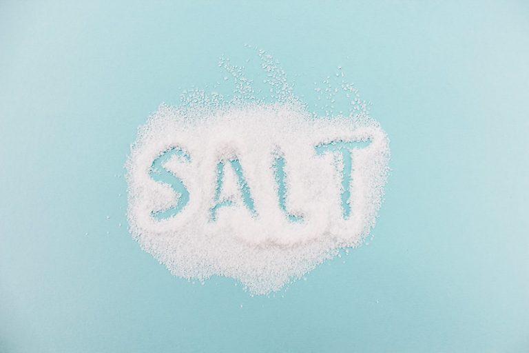 salt spelled out in a pile of salt