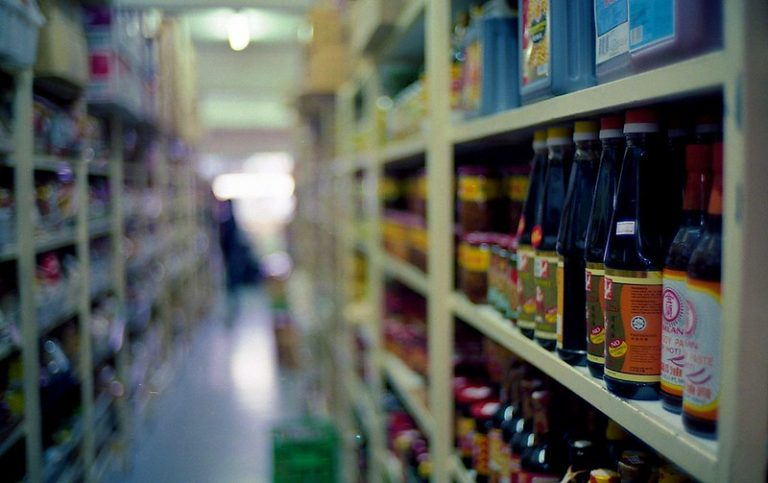 Image of an Asian grocery store aisle filled with soy sauces