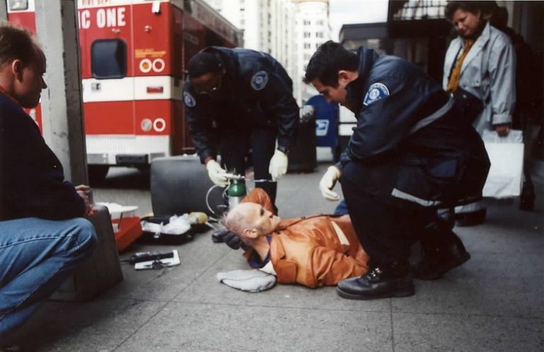 man with a stroke next to an ambulance