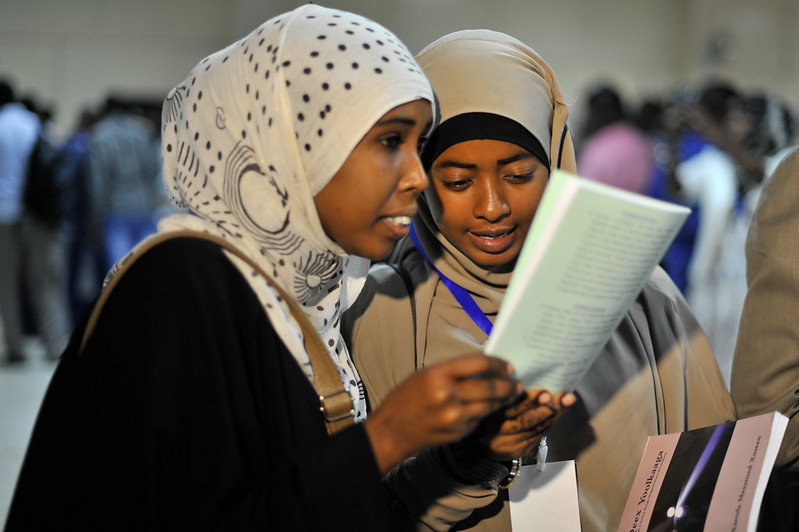 two Somali women reading
