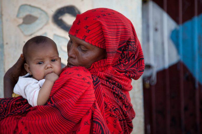 Somali woman holding baby