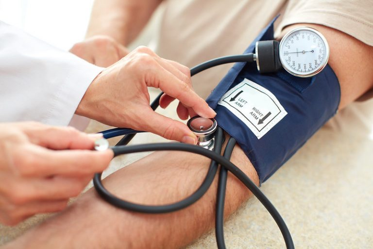 checking pulse and blood pressure