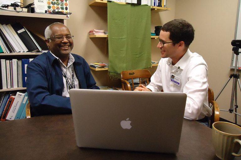 Language expert Mekonnen Gebretsadik and Benji Perin discussing Tigrigna phrases.