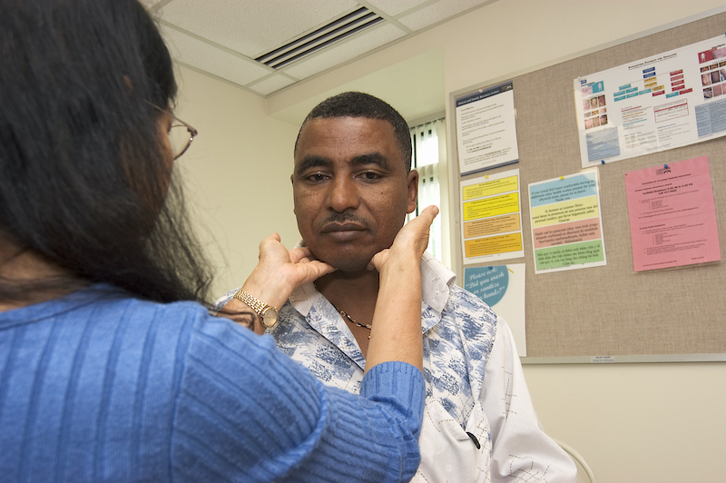 A provider doing a physical exam on a patient