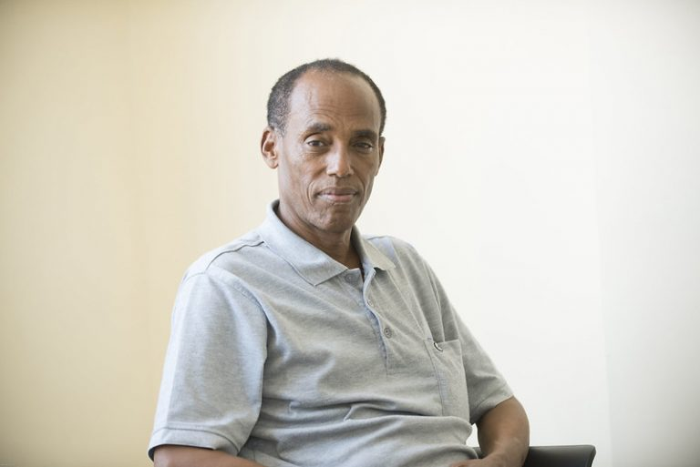 An Ethiopian man sitting in a chair