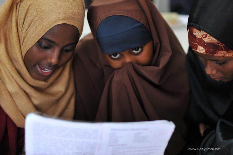 3 Somali girls looking at a paper