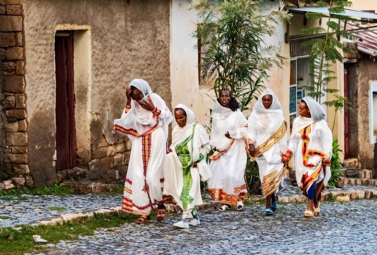 5 women walking in traditional Ethiopian dress