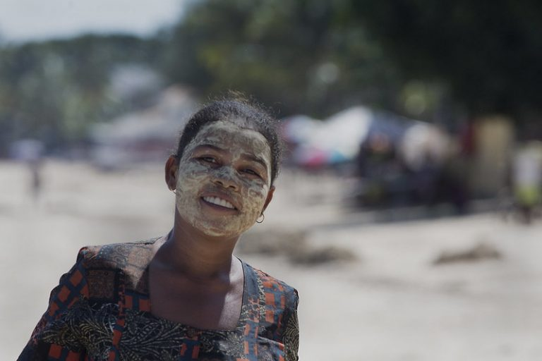 African woman with light cream covering her face