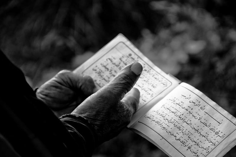 Someone reading the Koran.
