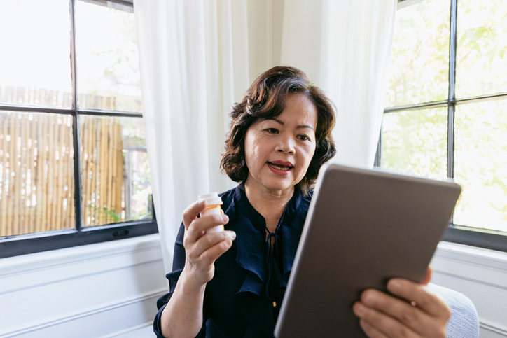 Senior woman talks with a doctor online