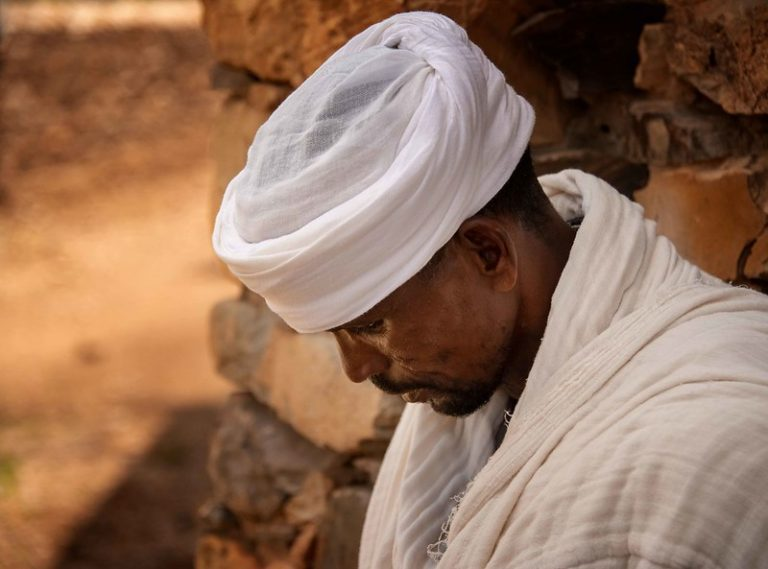 Ethiopian Orthodox priest praying.