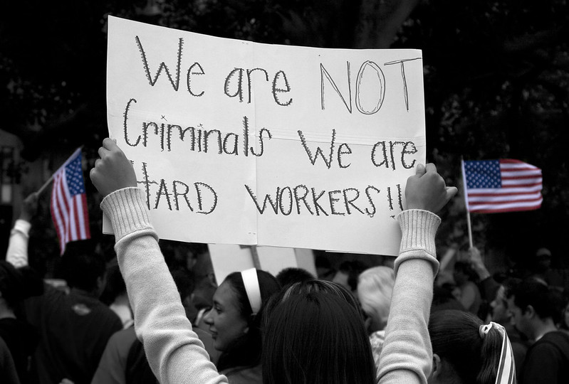 "Sign saying ""We are not criminals, we are hard workers"""