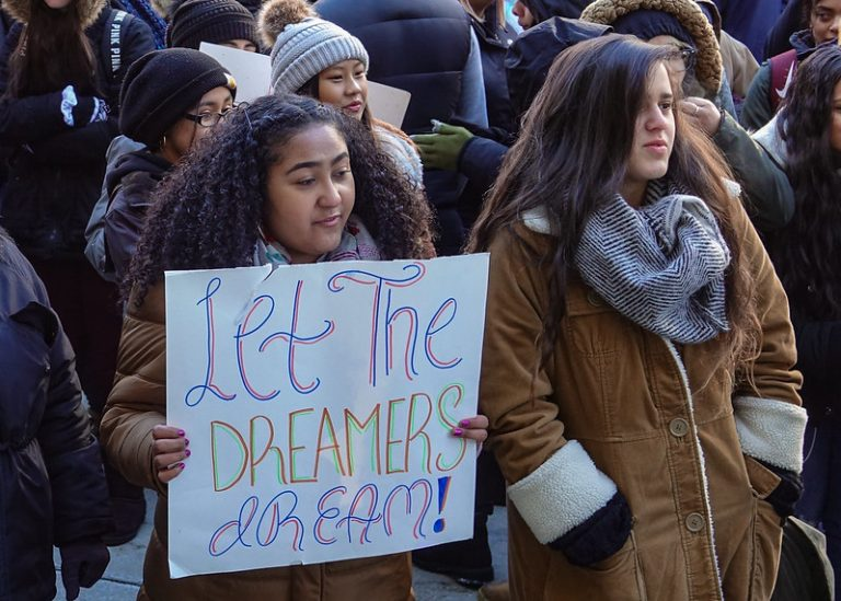 Protestors with sign saying Let the Dreamers Dream
