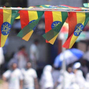 Ethiopian flags flying at event.